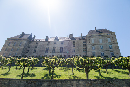 View of a beautiful castle property in Perigord in France with sun sky