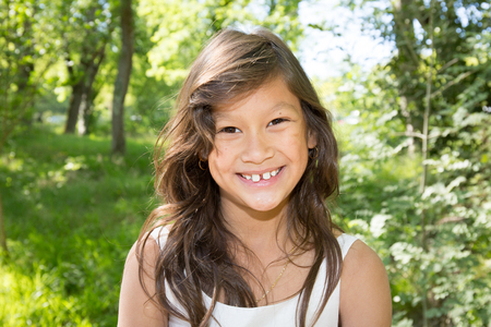 nine year old: beautiful girl with a beautiful smile Stock Photo
