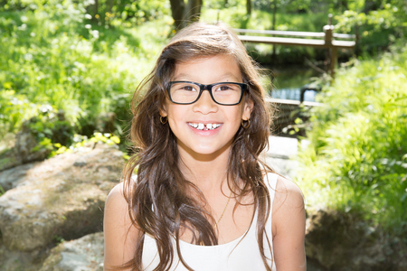 ten year old girl with long hair outdoor park Stock Photo