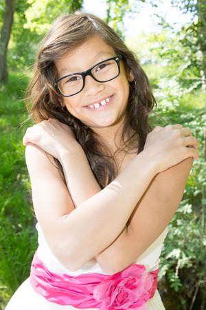 ten year old girl with long hair outdoor park with glasses