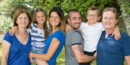 Happy family of in park garden house Stock Photo