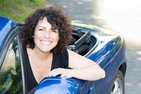 smiling woman cheerful and happy in summer car Reklamní fotografie