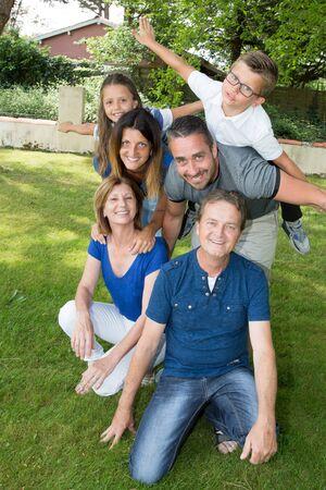 intergenerational family in green garden