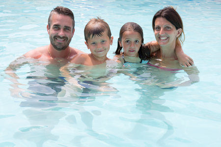 woman in bath: kids boy and girl in summer pool with parent