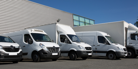 park society specialized delivery with small trucks and van Foto de archivo
