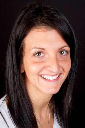 smiling pretty girl in black background