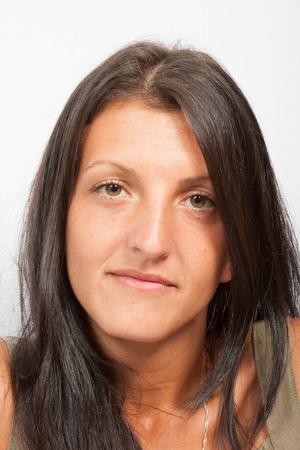 portrait brunette girl in grey background Stok Fotoğraf