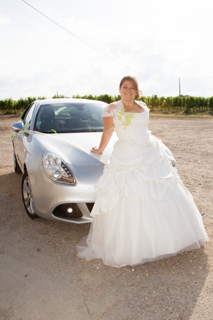 blond bride sit on wedding sport car Stock Photo