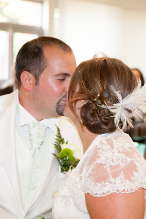 couple married a kiss in front of their guests at the exit of town hall