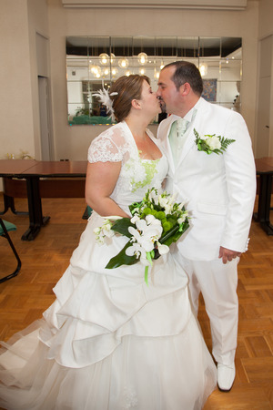groom and bride kissing after the wedding ceremony on hall town Stock Photo