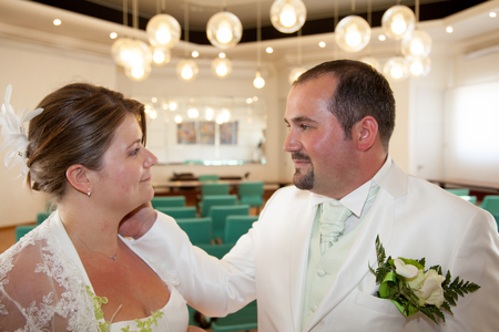 Groom touch bride neck in vintage city hall