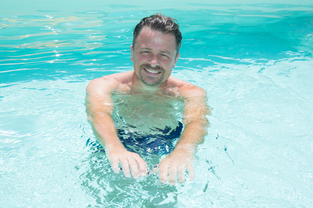 Photo of handsome man in swimming pool