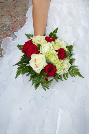 Bride holding in hand wedding bouquet Stock Photo