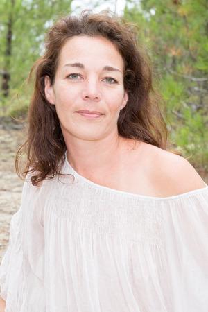 Close Up Portrait Of Smiling Brunette Woman Outdoors