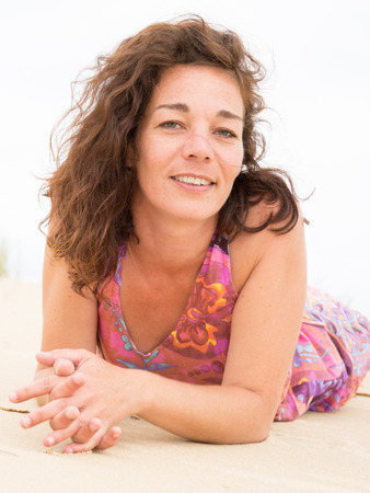 Close up lifestyle portrait of happy happy woman on beach with true emotions