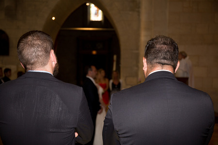witnesses man watching the bride and groom in religious ceremony in the church Stock Photo