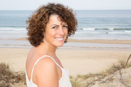 Outdoor portrait of young beautiful woman beach in background Stock Photo