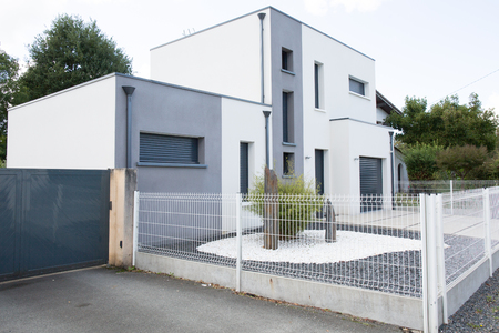 sold small: new modern architectural design style with white painted surface wall outdoor bright grey decoration frame on the facade Stock Photo