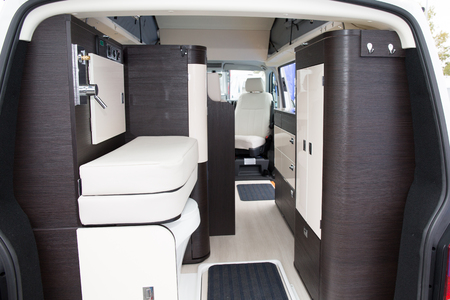 Vehicle interior view of a motorhome Modern Area Inside the Camper. Traveling with Style. Stock Photo