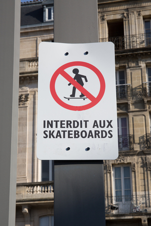 round: city sign write in french interdit aux skateboard meaning in english no skateboarding