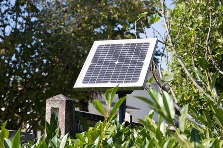 is green: small solar photovoltaic panel for the electric gate door