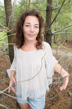 is green: Portrait of attractive young brunette posing outdoor