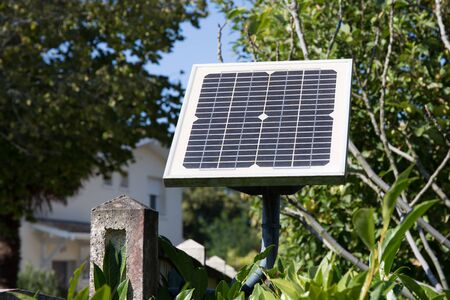 is green: photovoltaic gate electric system for open door home Stock Photo