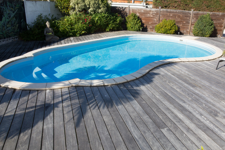 View of swimming pool with teck wood flooring Stock Photo