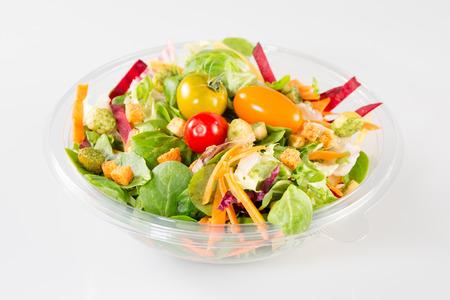Takeaway salad on white background