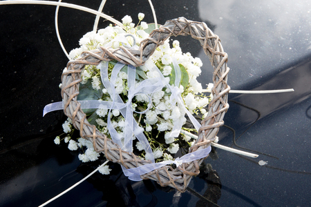 heart in flower with the alliances rings for wedding Stock Photo