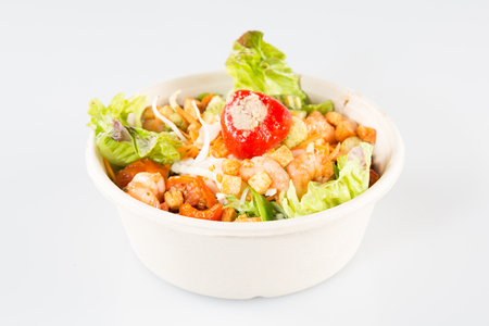Close up of take away bowl with fast food fresh vegetable salad