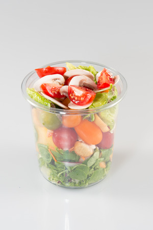 Healthy salads in plastic cups Take away lunch. Vegetarian food concept