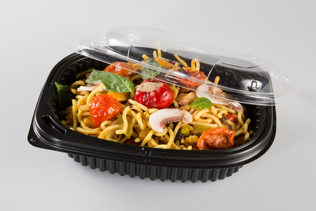 eating lo mein out of chinese take out box