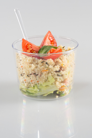 salad in takeaway cup on white background