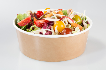 chinese Salad in carton takeaway container on white background