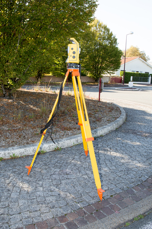 surveyor at work with an infrared reflector used for distance measurement on roadside land surveying professional