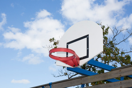 Basketball hoop in the park in the sky with the clouds