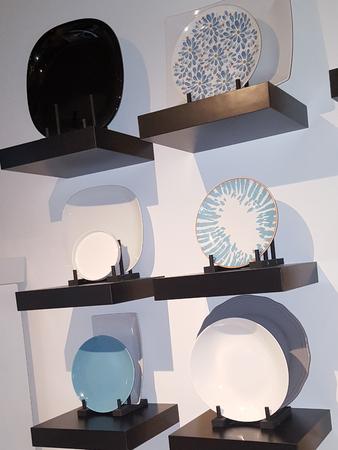 some shelves with plates in kitchen decoration Standard-Bild