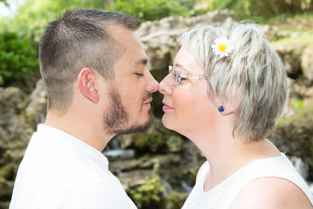 complicity couple in love at outdoors park summer Banque d'images