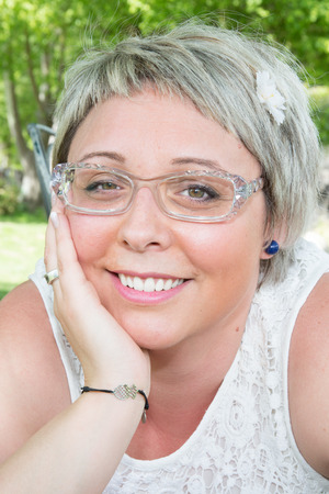 Closeup portrait of an elegant middle aged woman wearing glasses