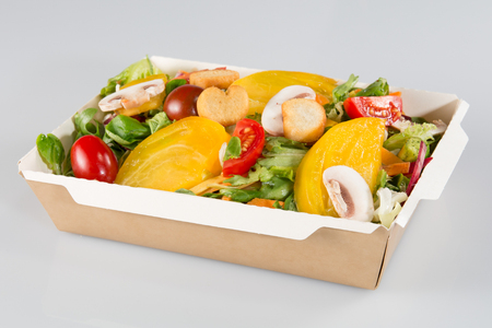 big salad in a cardboard dish of a fast food take away