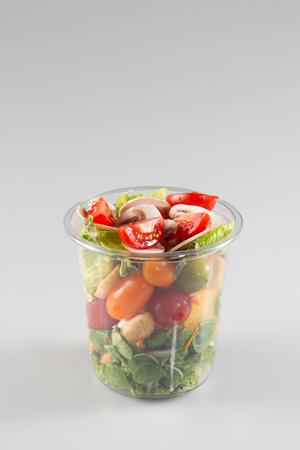 prepared salad in plastic takeaway containers