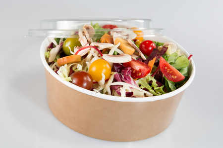 Close up takeaway bowl with fast food salad