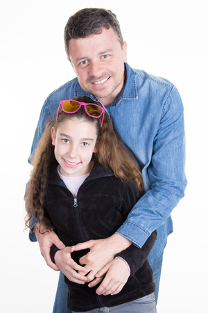 family father with his daughter standing on a white background
