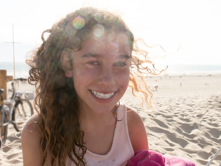 Young attractive woman young girl near the ocean on a summer day with sun Stock Photo