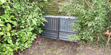 Black plastic composting bin for Making compost from green waste Stock Photo