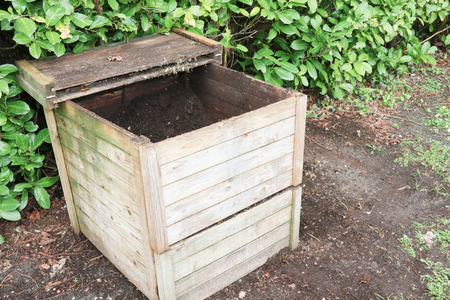 Small wood outdoor composting bin for recycling kitchen and garden organic waste Standard-Bild