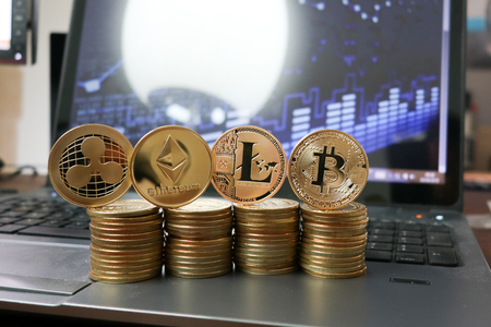 Golden cryptocurrency Bitcoin, Ethereum, Litecoin and ripplecoin Business concept image