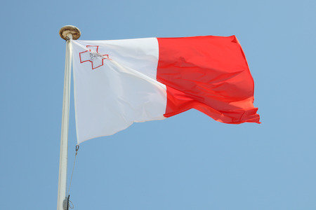 Malta flag on a mat in the wind and blue sky