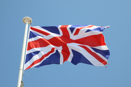 uk flag british on a mat in the wind and blue sky